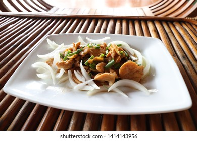 Sach moan char knhey, khmer dish of stirfried chicken with crispy fried ginger with sauce