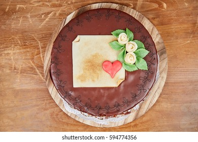 Sacher chocolate cake for birhtday on brown wooden table