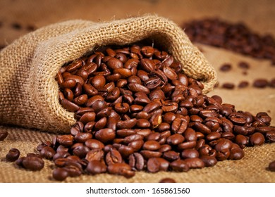 sack bag with coffee arabica on textile background