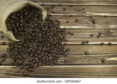 Sack coffee on a woody background