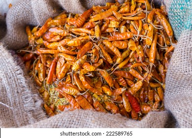 A sack full of dried hot yellow chillies in a sack at Market , Leh, India
