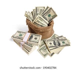 Sack full of money / studio photography of bag with hundred dollar bills