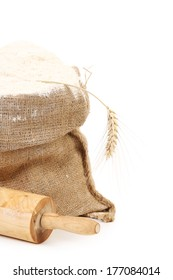 Sack and rolling pin. Isolated on a white background.
