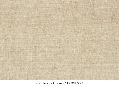 Sackcloth or burlap background with visible texture. Closeup of light natural sackcloth, canvas, fabric, jute, texture pattern for backdrop