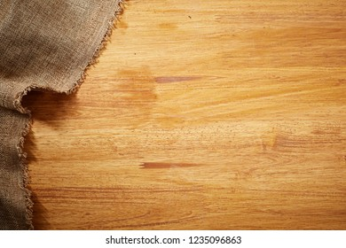 sackcloth on wooden background