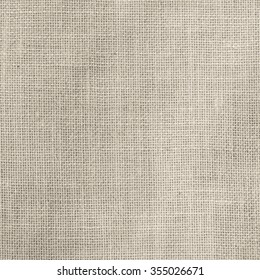 Sackcloth woven texture pattern background in light sepia tan cream brown color tone