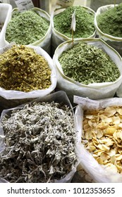 Sacks of dried herbs on sale in Souq Waqif, Qatar, Arabia. The leaves are used in traditional infusions and cookery.