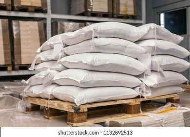 sacks of flour on pallets in warehous
