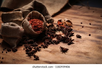 Sacks and spices on wood