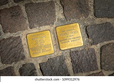 Sackstrasse,Graz, Austria - May 27, 2018: Two Stumbling Blocks (Stolpersteines), stone cobblestone monument in the street with names of victims of Nazi extermination -(Maria and Michael Dicker)