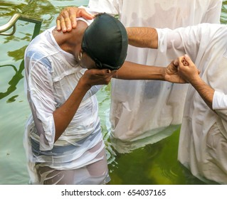 The Sacrament of Baptism on the Jordan River (Yardenit) The woman is in ecstatic delight during the passage of the rite of baptism.