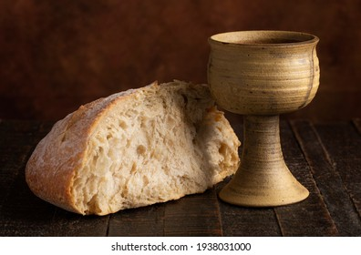 The Sacrament of Holy Communion  on a Dark Wooden Table