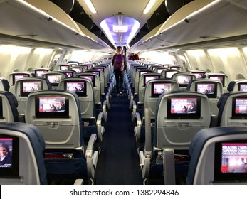 SACRAMENTO, CA - APR 25, 2019: Delta airplane airplane interior with person deplaning.