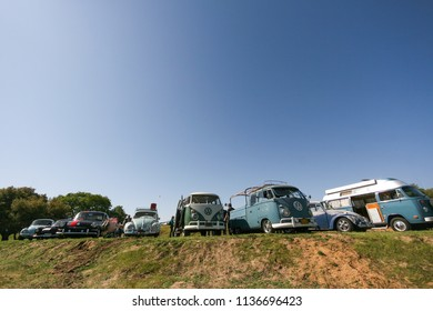 Sacramento, CA - April 5, 2009: Volkswagon cars participating in VW event called Ranch Run. Row of vintage German VWs buses and beetles on display with copy space in the sky.