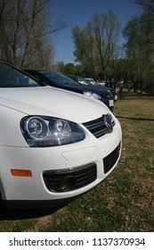 Sacramento, CA - April 5, 2009: Volkswagon cars participating in VW Ranch Run charity event. Newer VW model front side view of car, headlight being the center.