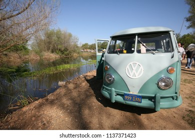 Sacramento, CA - April 5, 2009: Volkswagon cars participating in VW Ranch Run. Vintage VW van parked by small lake for camping.