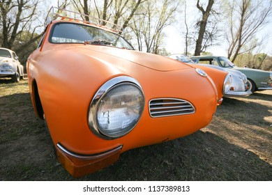 Sacramento, CA - April 5, 2009: Volkswagon cars participating in VW Ranch Run. Classic old vintage Volkswagon in orange color at car show.