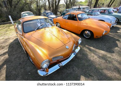 Sacramento, CA - April 5, 2009: Volkswagon cars participating in VW Ranch Run. Row of brightly colored old classic VW vehicles.