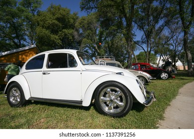 Sacramento, CA - April 5, 2009: Volkswagon cars participating in VW Ranch Run. Second annual event for VW enthusiasts. White VW Beetle on grass for carshow during the day.