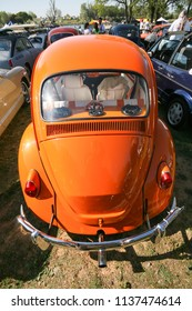 Sacramento, CA - April 5, 2009: Volkswagon cars participating in VW Ranch Run. Orange VW Beetle from the back with a model of same car inside.