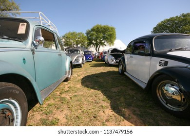 Sacramento, CA - April 5, 2009: Volkswagon cars participating in VW Ranch Run. Classic VW Beetles driving out from the car show at a Ranch.