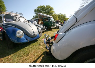 Sacramento, CA - April 5, 2009: Volkswagon cars participating in VW Ranch Run. Wide view of classic vintage VW beetles at a ranch for motor show.