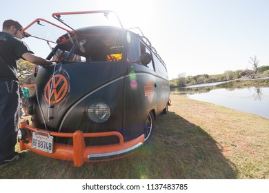 Sacramento, CA - April 5, 2009: Volkswagon cars participating in VW Ranch Run. Modified black and orange VW van at car show.