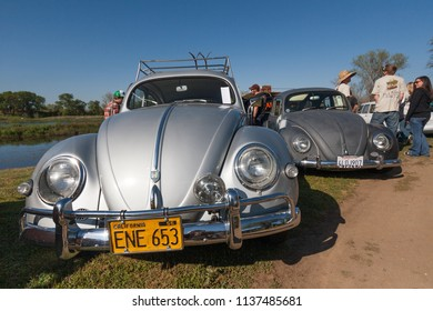 Sacramento, CA - April 5, 2009: Volkswagon cars participating in VW Ranch Run auto gathering. Silver matte classic VW Beetles outdoors at car show.