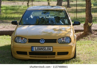 Sacramento, CA - April 5, 2009: Volkswagon cars participating in VW Ranch Run. Yellow modern VW GTi, golf.