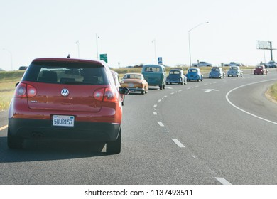 Sacramento, CA - April 5, 2009: Volkswagon cars participating in VW Ranch Run. German cars, GTi and others, getting onto the highway to go on a ride.