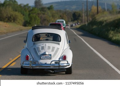 Sacramento, CA - April 5, 2009: Volkswagon cars participating in VW Ranch Run charity event. White VW Beetle in the back of the line.