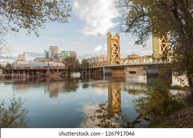 Sacramento, CA - August 11, 2012: View of the famous Riverwalk and dock on the edge of Old Sacramento, with Tower Bridge behind trees.