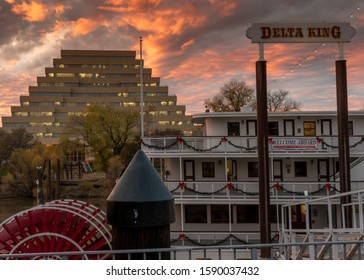 Sacramento, CA, Dec 12, 2019. View of the Zigurat Building and  Delta King riverboat Hotel in the sunset, Old Sacramento, USA