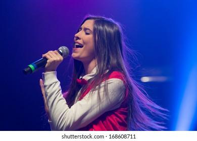 SACRAMENTO, CA - DECEMBER 2013: Lauren Cimorelli of Cimorelli performs in support of 107.9 The End's 2013 Jingle Ball at Sacramento's Memorial Auditorium in Sacramento, California on December 21, 2013