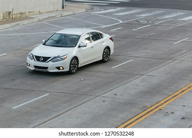 Sacramento, CA - December 29, 2018: Newer Nissan Altima driving on an empty road in downtown.