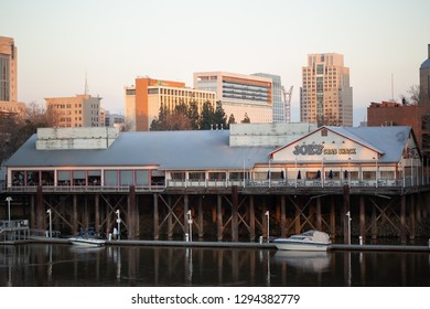 Sacramento, CA - January 12, 2019: Joe's Crab Shack in Old Sacramento with downtown skyline in the back.