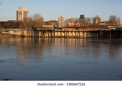 Sacramento, CA - January 12, 2019: Skyline of downtown Sacramento across the river and Old Town. Copy space  on water.