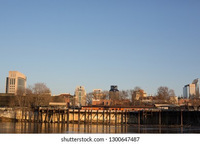 Sacramento, CA - January 12, 2019:  Sacramento downtown skyline view from West side of the river flowing next to Old Town.