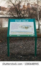 Sacramento, CA - January 12, 2019: West Sacramento River Walk stationary poster seen near the river in the background. Describers the flow of Sacramento River.