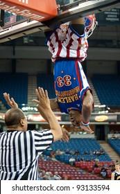 SACRAMENTO, CA - JANUARY 15: Bull Bullard hangs from the hoop during a Harlem Globetrotter game at Power Balance Pavilion in Sacramento, California on January 15, 2012