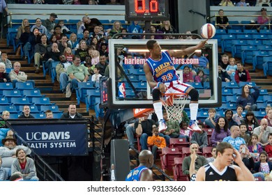 SACRAMENTO, CA - JANUARY 15: Bull Bullard sits on hoop at The Harlem Globetrotters game at Power Balance Pavilion in Sacramento, California on January 15, 2012