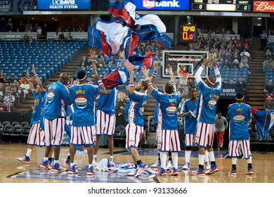 SACRAMENTO, CA - JANUARY 15: The Harlem Globetrotters remove their workout pants before the game against the International Elite at Power Balance Pavilion in Sacramento, California on January 15, 2012