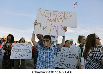 SACRAMENTO, CA - JUNE 01, 2016: protestors stand outside a campaign event to protest presumptive Republican presidential nominee,