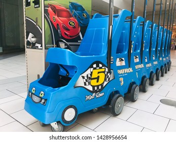 Sacramento, CA - June 16, 2019: Mall Racer kid carts inside Arden Fair mall. Police patrol type. Pay to rent while you shop.