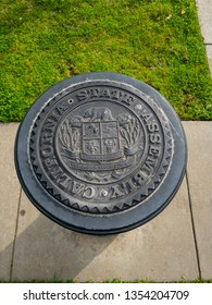 Sacramento, CA - March 24, 2019: State of California Assembly iron seal near the Capital building, in the park.