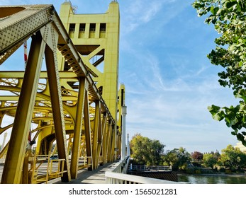 Sacramento, CA - November 16, 2019: Famous tower bridge in Sacramento over the river on a sunny clear day.