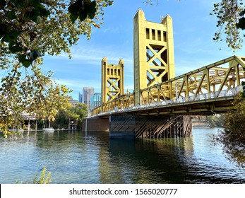 Sacramento, CA - Novmber 16, 2019: View of famous Tower bridge in gold over the Sacramento River in downtown.