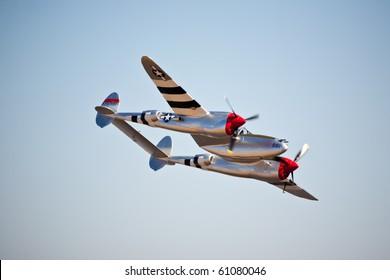 "SACRAMENTO, CA - SEPT 11: Vintage P-38 Lightning ""Honey Bunny"" flies at California Capital Airshow, September 11, 2010, Mather Airport, Sacramento, CA"