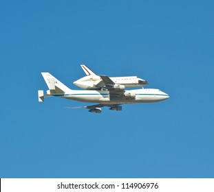 SACRAMENTO, CA - SEPTEMBER 21: The Space Shuttle Endeavor does a flyover at the California state capital in route to its final stop in Los Angeles, September 21, 2012 in Sacramento, CA.