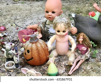 SACRAMENTO, CA, USA - APR 30, 2017: Randomly arranged scary dolls in a front yard of a house